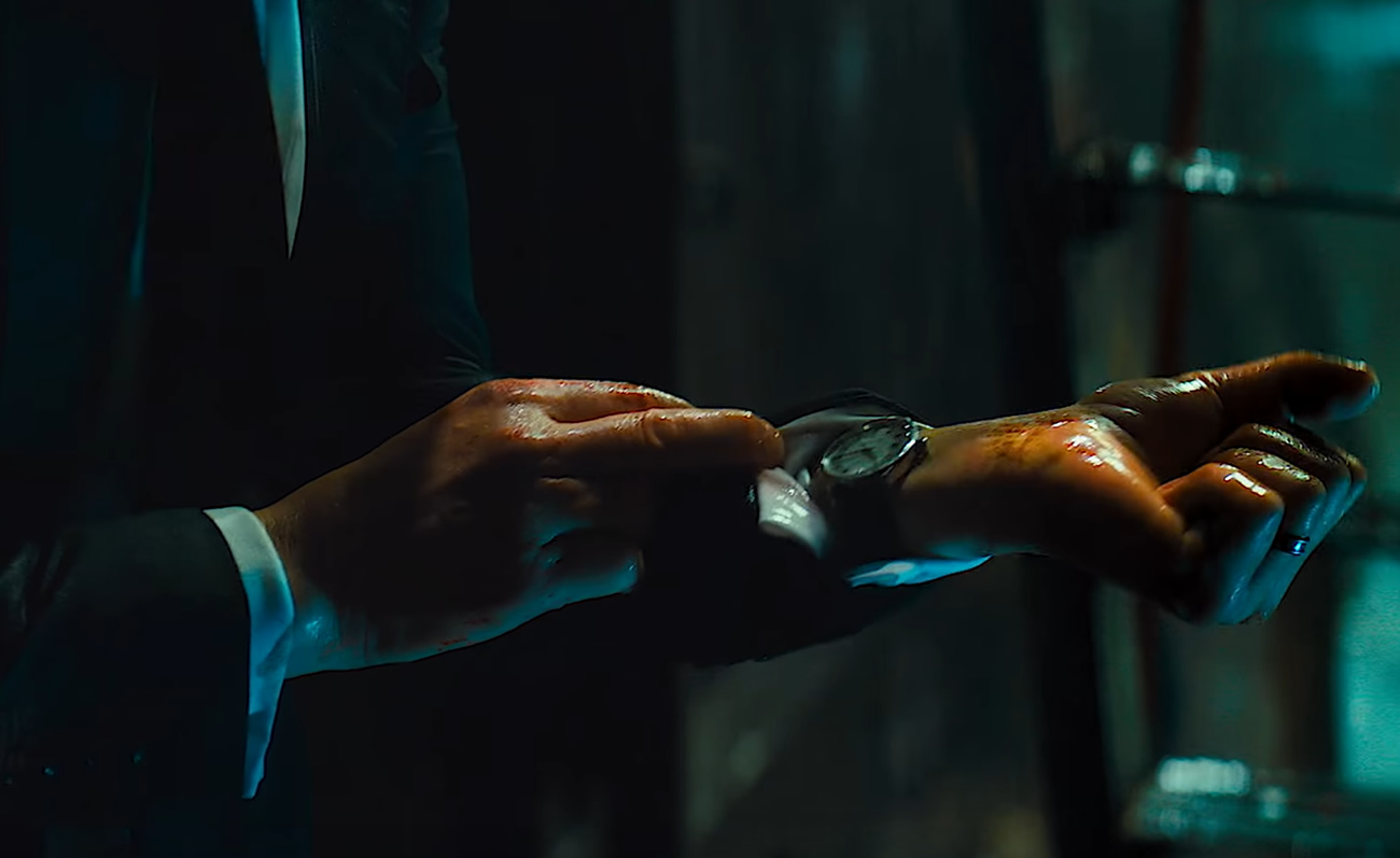John Wick Checking His Wrist Watch In John Wick 3 Parabellum
